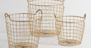 Featuring wire-wrapped handles and a slightly wavy weave, our gold metal baskets...