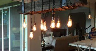 An Edison Light Inspired Railroad Tie Chandelier -----DESCRIPTION----- RETUR...